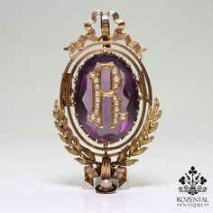 Period: Victorian (1836-1901) Composition: 18K Gold. Stones: - 1 Natural amethyst of 23mm by 13mm. - 17 Natural seed pearls Measures: 47mm by 29mm Thick: 10mm Total weight: 12grams – 7.7dwt This purch