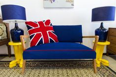 A wonderful little couch, recovered in royal blue with red piping (R4000). The Union Jack cushion is 60x60cm and made from felt (R750). Available @ HOME AFFAIRS mid century FURNITURE, 407a Albert Road Salt River Cape Town 0214473427