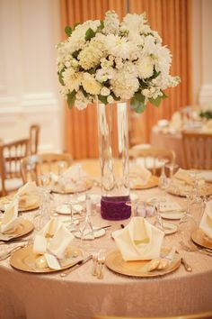 White & Champagne florals, with a splash of eggplant; Agapeplanning.com