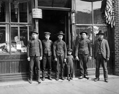 Chinese men and small boy  VPL Accession Number: 8056A  Date: 19--  Photographer / Studio: Unknown  Content: Chinese men and small boy in front of Tai Sing Co., Importers and Wholesale Dealers, General Merchandise  http://www3.vpl.ca/spe/histphotos/