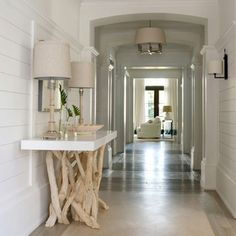 driftwood legged console. Recycled and reused and that gorgeous design so well done just love it in such a fancy home