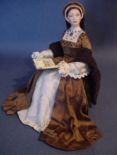 CATHERINE HOWARD:     A miniature china-painted porcelain doll by me.