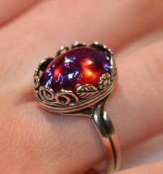 Dragons Breath Mexican Fire Opal ring set in leaves and spirals. Sterling silver #ArtistiqueThings