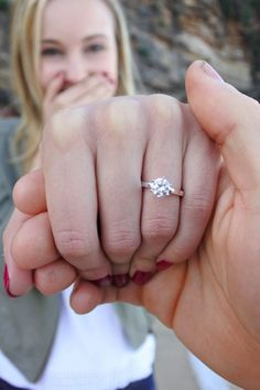 This gorgeous solitaire engagement ring is a definite yes!