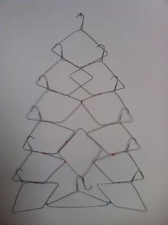 wall hanging space saving christmas tree using coat hangers... Hmmm, I think I could put my touch on this & make it awesome.  Great idea for the foundation of a hanging Christmas Tree <3
