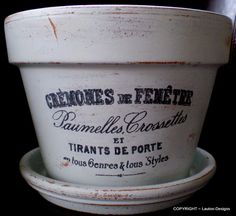 French Advertising Clay Pot: Terracotta clay pot, painted, distressed in spots, then a French Advertising image was added.