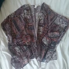 Kimono Kimono from wet seal. I need more room in my closet and I just wasnt wearing this anymore Wet Seal Tops