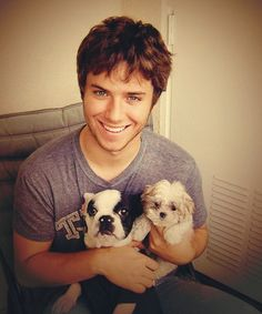 Jeremy Sumpter with puppies... My childhood crush on Peter Pan shall probably never cease.