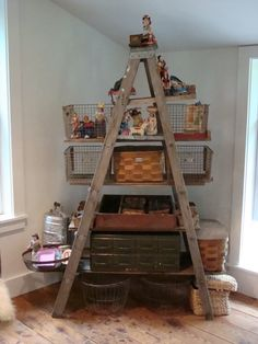 we keep meaning to make ladder shelves... some day. also: metal milk crates