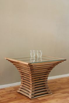 This table was created by playing with lines and mathematical proportions. All corners are straight, but curved lines are created by the construction. This construction is through the use of the glass table top clearly visible. Material and dimensions are customizable.    Table on images:  material: ELMS and tempered glass  size: B57 D57 H45 cm