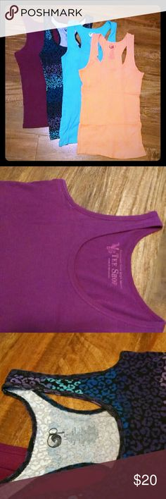 SALE🍹 Tank Top Bundle Four tank tops. Purple/fuschia tank is from VICTORIA'S SECRET, Sz medium, all others are OP and are size large and are longer fitting-not enough to cover the bum completely but keep the waistband of your jeans or shorts covered.  Good condition with some pilling and general wear from washing. Cross posted. Victoria's Secret Tops Tank Tops