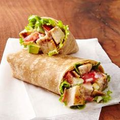 Chicken Club Wraps from Eating Well Whole-wheat tortillas provide a tasty twist in this quick grilled chicken breast recipe that combines all the elements of a classic club sandwich into a wrap. Cheap Healthy Lunch, Healthy Wraps, Healthy Lunches, Protein Wraps, High Protein, Healthy Cooking, Healthy Eating, Cooking Recipes, Healthy Recipes