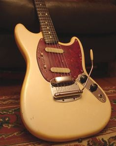 Fender Mustang, our dad bought my brother and I each one exactly like this, same color and everything.