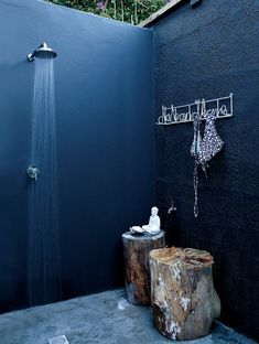 Once the basic fittings are in place, the fun can start – styling your shower. For a surf shack feel, try weathered tree trunks for seats...