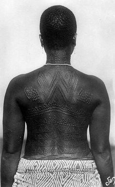 Scarification detail on a woman's back, Dahomey. Scanned vintage postcard; publisher Fleury.
