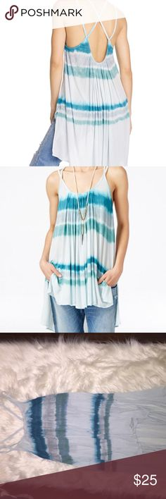 FreePeople Fly By Tank Top Size xs. A tie-dye design gives a refreshing look to this Free People™ Fly By Tank Top. Lightweight jersey fabrication. Oversized silhouette. Scoop neckline. Sleeveless design. Gathered details throughout. Crossing strap detail at back lends to peek-a-boo style. High-low hemline. 92% modal, 8% spandex. Hand wash and lay flat to dry. Imported. Measurements: Length: 24inch Free People Tops Tank Tops