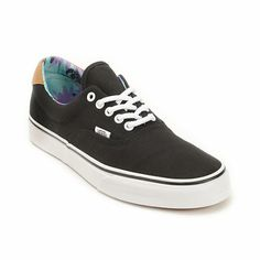 The Era 59 black and beach glass shoe from Vans has a classic skate shoe look with a printed interior for a pop of color. Built with a grippy vulcanized construction this shoe has a durable canvas upper that makes this a great casual skate shoe for any ac
