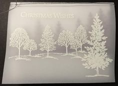 Heat embossed Lovely as a Tree on vellum with white EP. Inside layer is masked with same ground line, then stamped the firs in Perfect Plum.