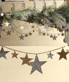 Let the season shine with this gold and silver glass glittered star garland on antiqued chain.