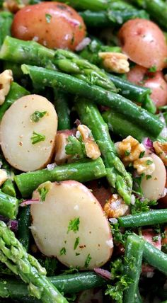 Potato Salad with Green Beans and Asparagus ~ This salad works really well at either room temperature or served cold. It has a bold, tangy taste thanks to the dijon mustard vinaigrette.