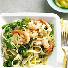 Lemon-Dill Shrimp & Pasta 12 ounces frozen peeled and deveined medium shrimp, thawed 1 lemon 8 ounces dried fettucine 2 tablespoons olive oil 3 cloves garlic, thinly sliced 6 cups baby spinach 1/2 teaspoon Italian seasoning, crushed   Salt and ground black pepper   Fresh dill (optional)