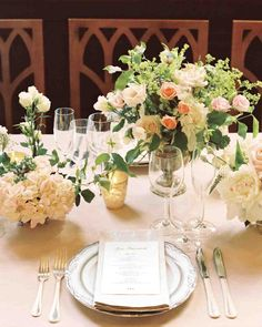 17 Creative Ways to Set Your Reception Table | Martha Stewart Weddings - Event planner Claudia Hanlin of The Wedding Library set the table at this New York City wedding with neutral linens, gold votives, and traditional china. Centerpieces featured roses, peonies, scabiosa, sweet peas, and privets.