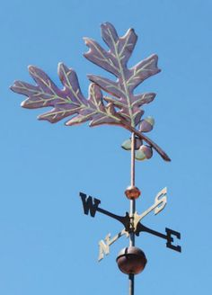 Double Oak Leaf Weather Vane by West Coast Weather Vanes.  This handcrafted oak leaf weathervane was custom made gilding the veining in the leaves and the acorns.