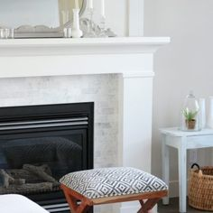 Benjamin Moore White Dove is a beautiful soft white paint colour with a hint of grey making it a popular choice for trim, cabinets, walls and more. Love White Dove on this fireplace with marble surround! #whitedove #whitefireplace #whitedovepaint #bestwhitepaint Best White Paint, White Paint Colors, Favorite Paint Colors, Reface Fireplace, White Fireplace, Basement Wall Colors, Light Gray Cabinets, Benjamin Moore White, Reclaimed Wood Dining Table