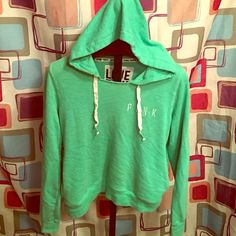 Green pullover hoodie Green pull over hoodie with side pockets. Good condition. Is a little oversized but I like my hoodies super baggy! This would def fit an xl. Has a raw hem near the top and is super cute on PINK Victoria's Secret Sweaters