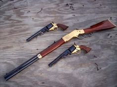 Three beautiful weapons: one Winchester rifle and Two Colt Navy revolveres. Weapons Guns, Guns And Ammo, Henry Rifles, Black Powder Guns, Lever Action Rifles, Hunting Rifles, Hog Hunting, Cool Guns, Le Far West