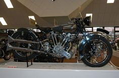 George Brough was without doubt the most outstanding figure in the motorcycle industry throughout the twenties and thirties and the SS100 model was his most outstanding product. Translated, SS100 meant Super Sports 100 mph. Tunder examples of the SS100 held the World's Two Wheel speed record five times, the last time in 1937 with a two run average of 169.7 mph and a one way speed of 175 mph. The SS100 was no circuit racer but mid-twenties racing versions won on sand and track and finished…