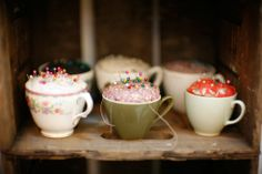 Pincushion in a teacup.    Fill cup with fiberfill, then hot glue scrap of fabric to cover cup.  So cute!