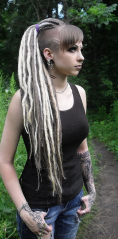 Alternative Dread Fashion >>> Definitely not my style, but I love the bold look of this side shaved dreadlock fashion.
