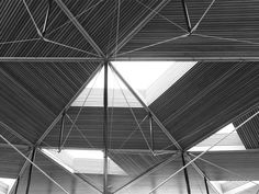 St John & St James CE Primary School, Enfield, by Scabal: The roof structure showing the bowstring trusses. Photo: Simon Feneley