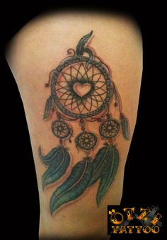 """Dreamcatcher Tattoo, Love the heart in the middle and wouldn't want the smaller """"catchers"""" but five feathers w/kids names on each one"""