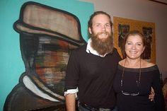 Kate Mulgrew and son, Alec Egan. Paintings in the background were done by Alec Egan.