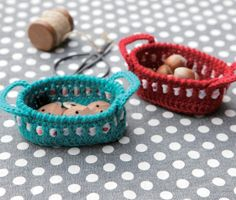 Tiny crocheted baskets.  Pattern is in Japanese.