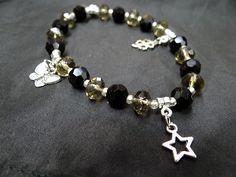 piedras negras y amarillas colgantes estrella, mariposa y trebol