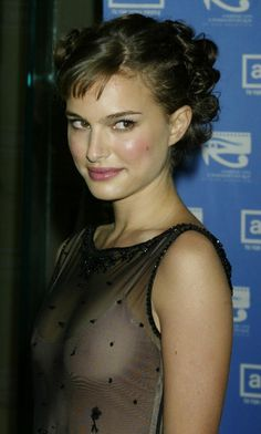 "Actress Natalie Portman poses as she arrives at the American Cinematheque Tribute to Nicole Kidman November 14, 2003 in Beverly Hills. Kidman received the 2003 American Cinematheque Award for her contributions to cinema. Portman stars with Kidman in the upcoming film ""Cold Mountain."""