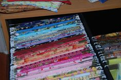 Organizing Your Stash - sew-whats-new.com.  Cut the top inch off of hanging file folders and fold the fabric over that to file them.  Works best for 1/4 yard - 1 1/2 yard pieces.