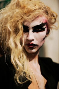 portrait involving crazy smudged makeup
