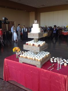 Small wedding cake with cupcakes.