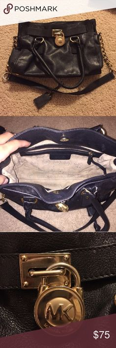 Black Michael Kors purse !!! Black Michael Kors purse with gold chain! Super cute bag that goes well with any outfit. Does show some signs of wear and there is minor damage to one of handles as shown in pictures above. Smoke free home! Michael Kors Bags Shoulder Bags