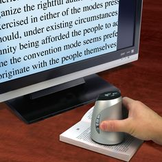 The Wireless Page To TV Magnifier - Hammacher Schlemmer. I so need this!