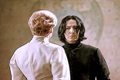 """2002 -- Kenneth Branagh as Professor Gilderoy Lockhart and Alan Rickman as Professor Severus Snape in """"Harry Potter and the Chamber of Secrets."""" This little GIF is from the dueling clup Professor Lockhart tried to get started. Professor Severus Snape, Harry Potter Severus Snape, Severus Rogue, Alan Rickman Severus Snape, Harry Potter Cast, Harry Potter Universal, Harry Potter World, Alan Rickman Movies, Kenneth Branagh"""