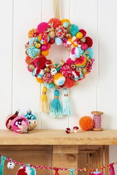 All the poms! Make a pom pom wreath in the latest Christmas issue of Mollie Makes. Comes with BONUS 2017 calendar & organiser stickers. Please choose cruelty free, go vegan! Mollie Makes, Bohemian Christmas, Noel Christmas, Christmas Wreaths, Christmas Pom Pom Crafts, Beautiful Christmas, Christmas Music, Colorful Christmas Decorations, Crochet Christmas Wreath