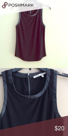 Rachel Rachel Roy faux leather trimmed top 💰SALE💰 Darling Rachel Roy faux leather trimmed top. Dresses up any outfit.  96% polyester , 4% Elastane RACHEL Rachel Roy Tops