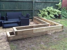 Raised planter made from Eco sleepers to frame patio area.