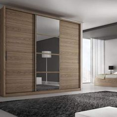 Your bedroom will never be the same.  The Bellevue 3-door wardrobe with its telescopic sliding doors giving easy access to clothing and personal items truly does have it all. The five roomy drawers with aluminum handles features safety locks to secure your valuable items. An optional set of mirrored doors creates a glamorous look for your space.  Shown in Chocolate Available on Cymax Stores  #HomeDecor #ManhattanComfort #Bellevue #Wardrobe #Bedroom #Casa #HomeDecor #Furniture #Armoire