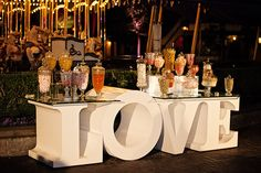 Assorted vases and fun table accents turn a candy bar into a focal point for a reception and a sweet piece of décor